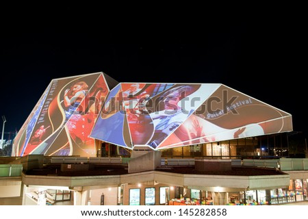 ADELAIDE, AUSTRALIA - JUNE 18: Digital images projected onto the Adelaide Festival Centre During the Houselights celebrating its 40th anniversary on June 18 2013.