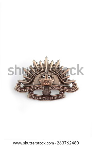 ADELAIDE, AUSTRALIA - MARCH 18, 2015: Australian Anzac WWI rising star hat badge on white background with copy space. - stock photo