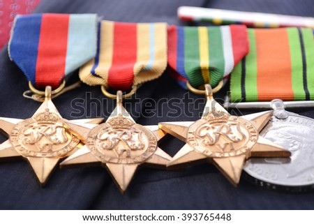 ADELAIDE, AUSTRALIA - MARCH 18, 2016: Original Australian Army WWII medals with the 1939 - 1945 Star, Africa Star, Pacific Star, Defence Medal, 1939 -1945 Medal and Australian Service Medal, closeup. - stock photo