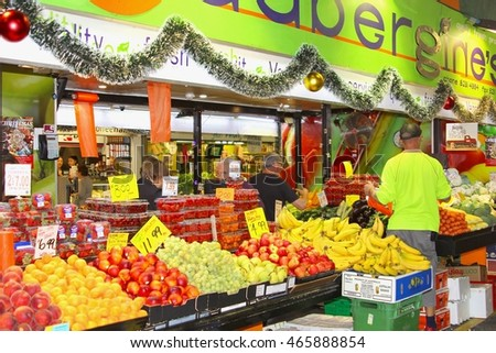 ADELAIDE, AUSTRALIA - November 27. People are buying and selling fresh fruits and vegetabels for Christmas at the greengrocery in the Central Market on November 27, 2015 in Adelaide.