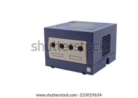ADELAIDE, AUSTRALIA - October 17, 2014: A studio shot of a Nintendo Gamecube console. A popular game console sold by nintendo worldwide during the early 2000's. - stock photo