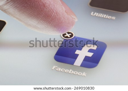 Adelaide, Australia - October 3, 2012: Deleting the Facebook app from an iPad by clicking the cross at the corner of the icon for the app.