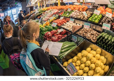 ADELAIDE, AUSTRALIA - SEPTEMBER 1, 2015 - People buying at town fresh market