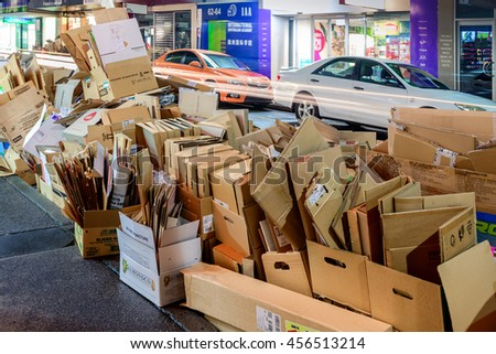 Adelaide, South Australia - August 11, 2015: Recyclable waste collection day in Adelaide city. Night view of the street with paper boxes