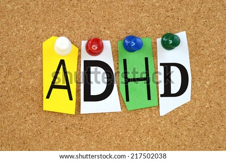 ADHD , abbreviation for Attention Deficit Hyperactivity Disorder in cut out magazine letters pinned to a cork notice board - stock photo