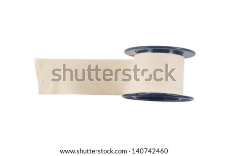 Adhesive bandage sticking plaster isolated over white background - stock photo