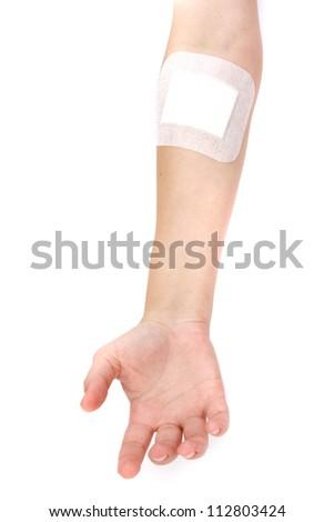 adhesive bandages on injury hand on white background - stock photo