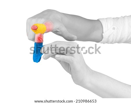 Adhesive Healing plaster on finger. Pain concept photo.