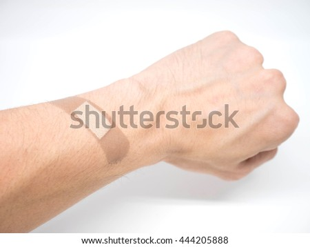 Adhesive Healing plaster putting on hand for first aid concept - stock photo