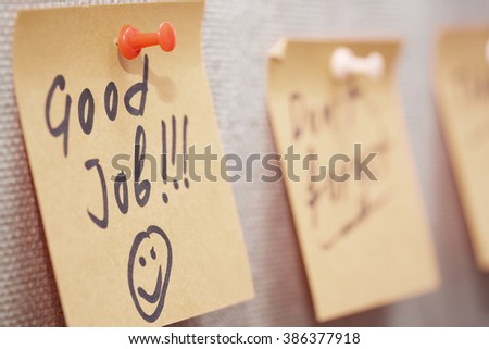 Adhesive note with Good Job text on a cork bulletin board - stock photo