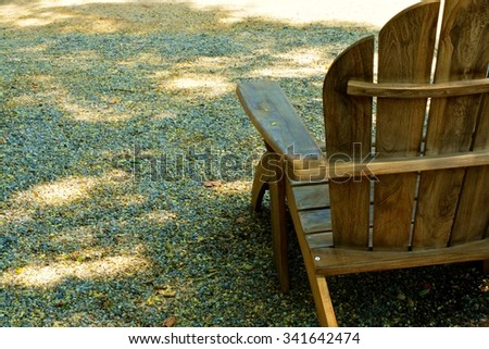 Adirondack Chair On Gravel Path