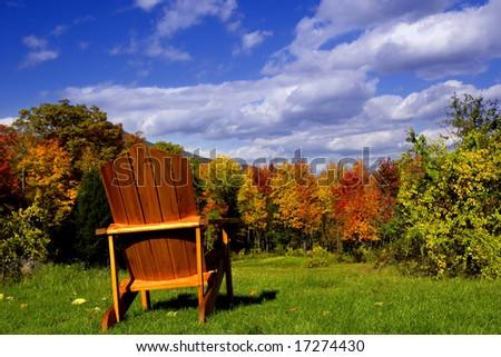Adirondack chair overlooking a beautiful fall landscape - stock photo