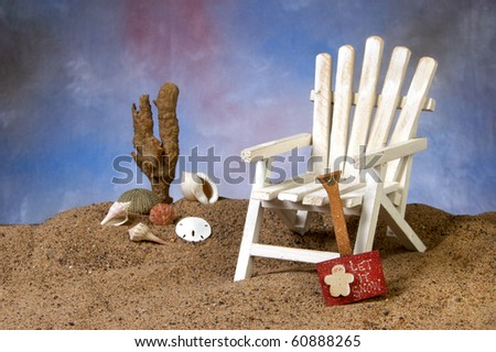 Adirondack chair with shovel and text let it snow, on the beach - stock photo