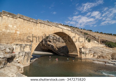 ADIYAMAN, TURKEY - AUGUST 24, 2015 : View of ancient historical Cendere Bridge, built in about 200 AC for Roma Imperiur Septimus Severus in Adiyaman.