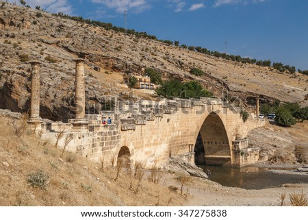 ADIYAMAN, TURKEY - AUGUST 24, 2015 : View of ancient historical Cendere Bridge, built in about 200 AC for Roma Imperiur Septimus Severus in Adiyaman. - stock photo