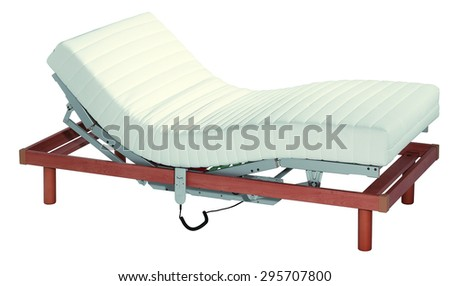 Adjustable motorized bed with a movable slats and orthopedic mattress, isolated on white - stock photo