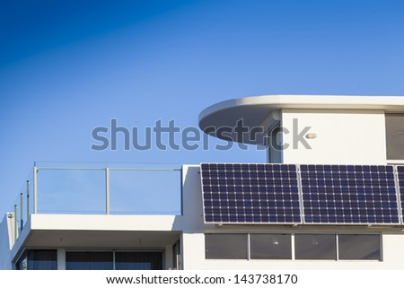 Adjustable solar panel installation on luxury home - stock photo