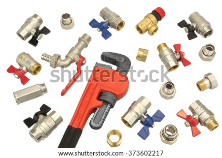 ball valve wrench. adjustable wrench and many ball valves with fittings isolated on white background, overhead or top valve
