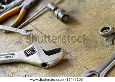 Adjustable wrench and tools for bike repairing - stock photo