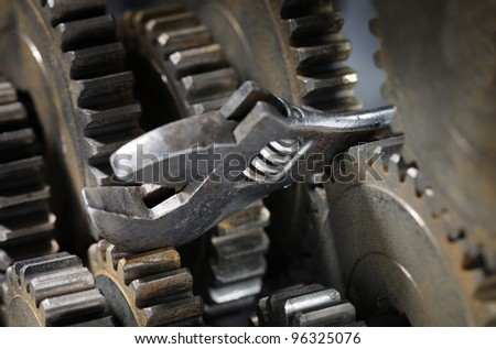 Adjustble spanner stuck between cog gear wheels.