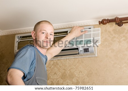 Adjuster air conditioning system sets a new air conditioner in the apartment. - stock photo