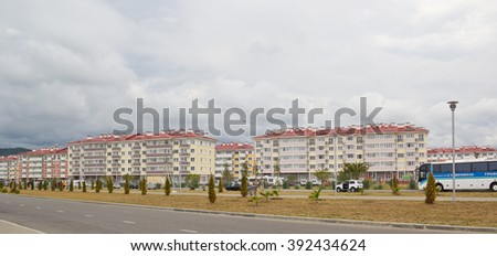 "ADLER, RUSSIA - AUGUST 9, 2014: ""Catherine's block"" city-hotel ""Velvet seasons"". The hotel complex is built for a summer Olympic games 2014 - stock photo"