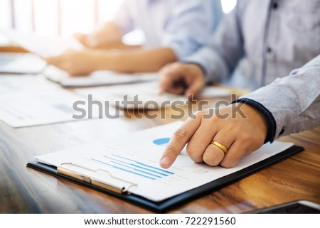 Administrator business man financial inspector and secretary making report, calculating balance. Internal Revenue Service checking document. Audit concept