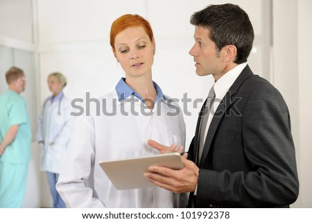 Administrator talking with Doctor at the Hospital - stock photo