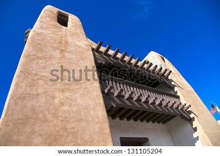 Adobe exterior accented with ornate woodwork in Santa Fe, New Mexico - stock photo