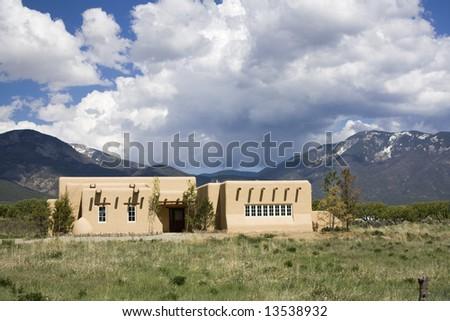 Adobe Mountain House in New Mexico. - stock photo