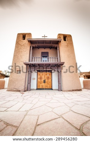 Adobe settlement consisting of dwellings and ceremonial buildings?? represents the culture of the Pueblo Indians of Arizona and New Mexico.