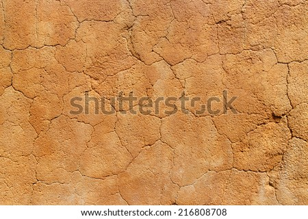 Adobe wall texture, material construction. - stock photo