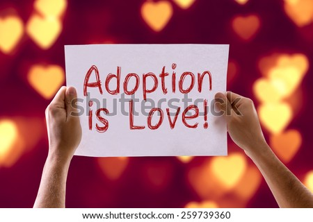 Adoption is Love card with heart bokeh background - stock photo