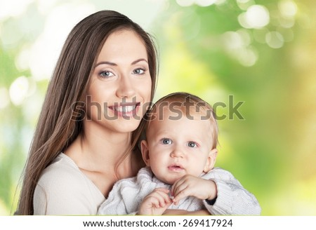 Adorable. A happy family. young mother with baby - stock photo