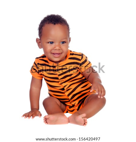 Adorable african baby with with brindle pajamas sitting on the floor isolated on a white background