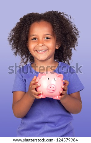 Adorable african little girl with piggy-bank isolated over blue background - stock photo
