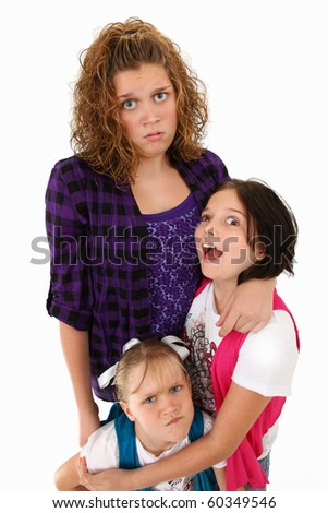 Adorable american sisters making silly faces over white background.