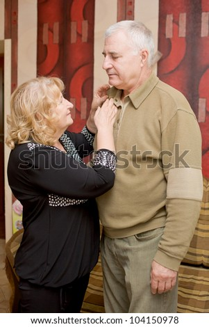 adorable amorous happy senior couple talking in the living room at home - stock photo