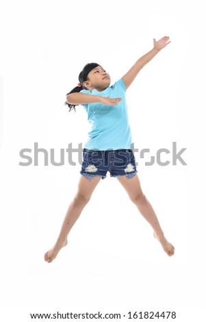 Adorable and happy little girl jumping in air - stock photo