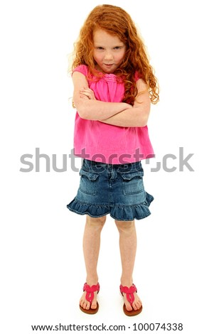 Adorable angry six year old girl with arms crossed in pink and blue over white. Curly long red hair. - stock photo