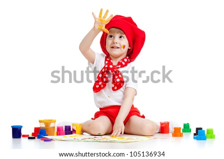 adorable artist kid drawing and painting by finger paints - stock photo