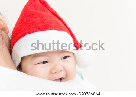 Adorable asian baby cute girl smiling with copy space in Christmas theme. (Vintage tone)