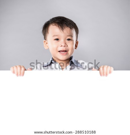 adorable asian child with blank advertising banner