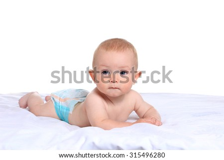 Adorable baby boy in pampers on blanket on a white background - stock photo