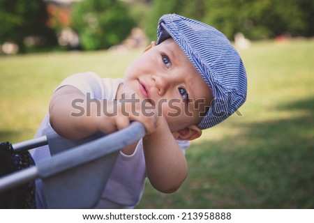 Adorable baby boy in park - stock photo