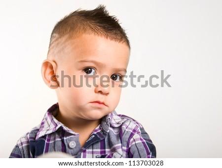 adorable baby boy making a suspicious face - stock photo