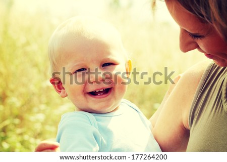 Adorable baby boy outdoors at sunny summer day  - stock photo