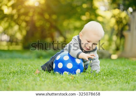 Adorable baby boy playing in the park - stock photo