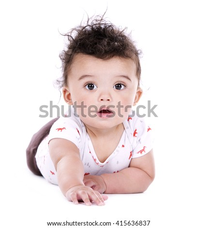 adorable baby boy posing on white studio background