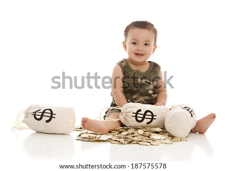 Adorable baby boy sitting in a pile of gold coins with money bags.  Isolated on white with room for your text. - stock photo